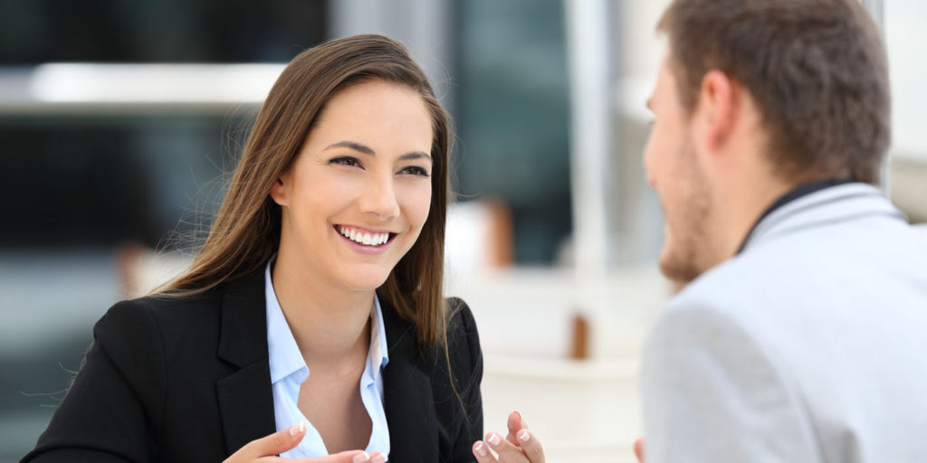 A woman and a man talking about business